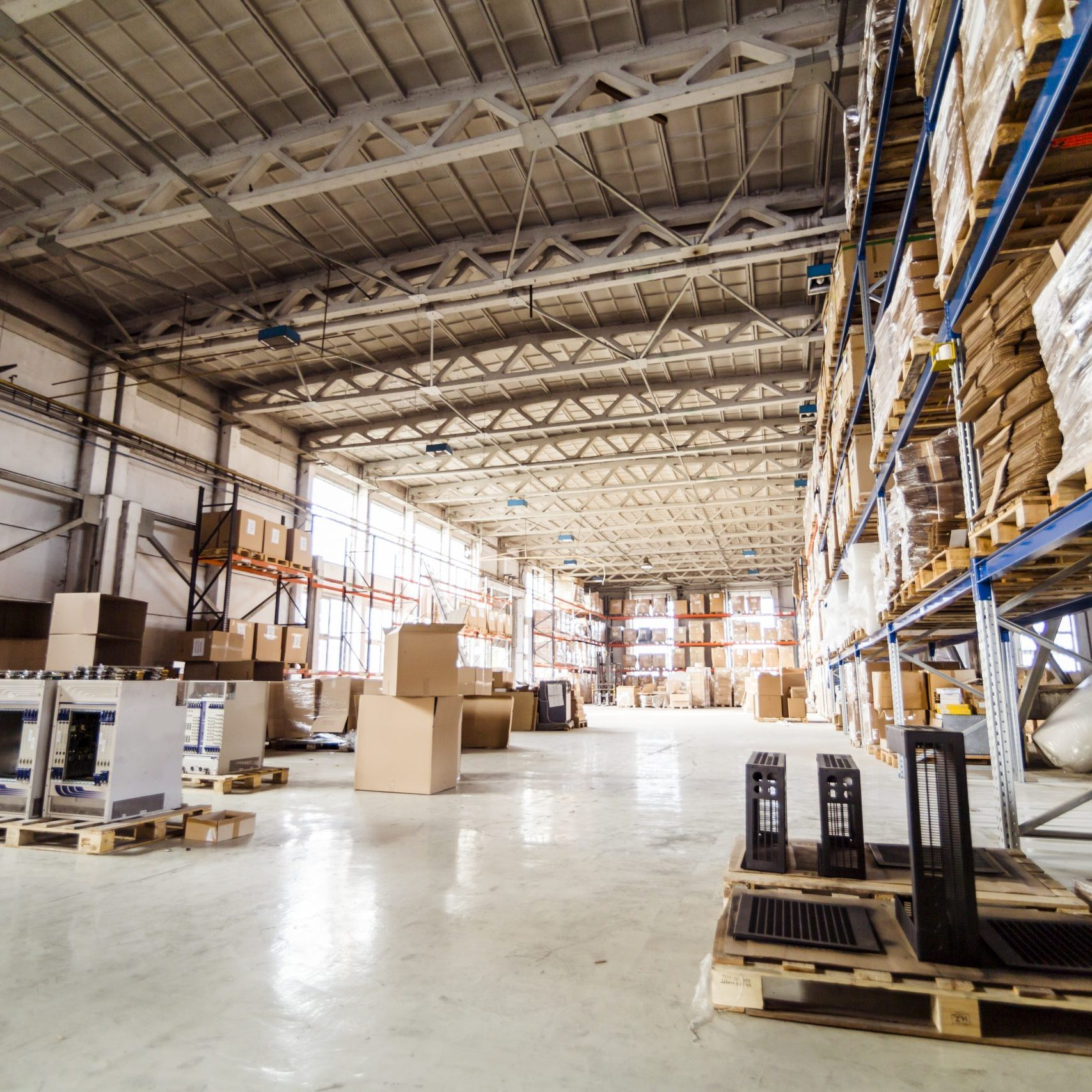 Pallets storing boxes in an industrial warehouse